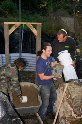 filling earthbags during construction