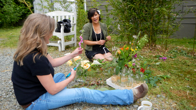 Lori and Georgie arranging flowers