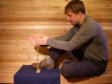 demonstrating the proper handdrill form