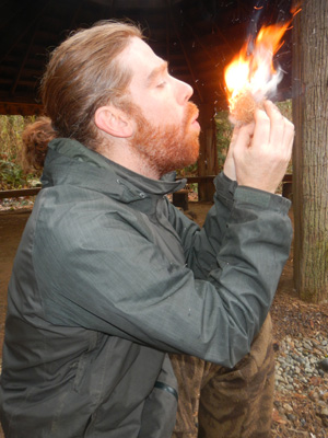 Instructor Gabe making fire