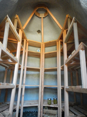 Interior of earthbag structure with shelves