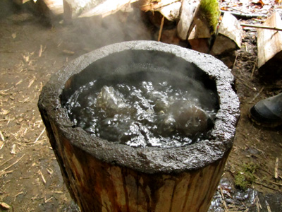 a coal-burned bowl boiling water